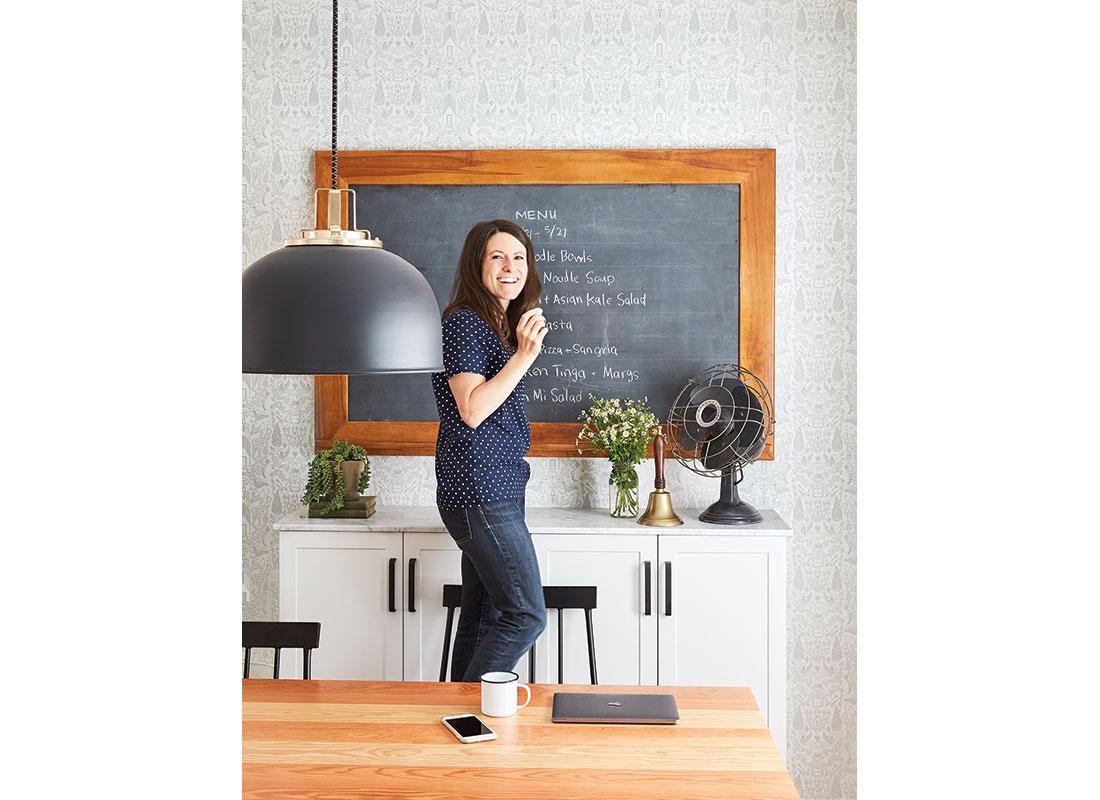 Melissa Coleman at chalkboard