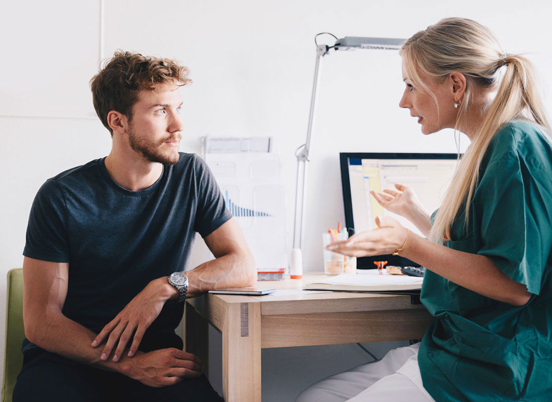 man talking to gynecologist