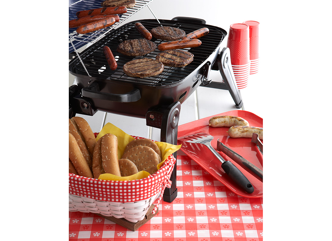 hot dogs and burgers on the grill