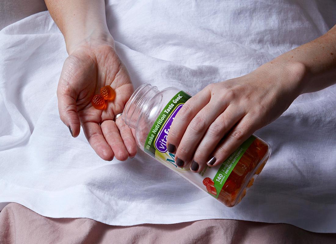 woman taking melatonin pills