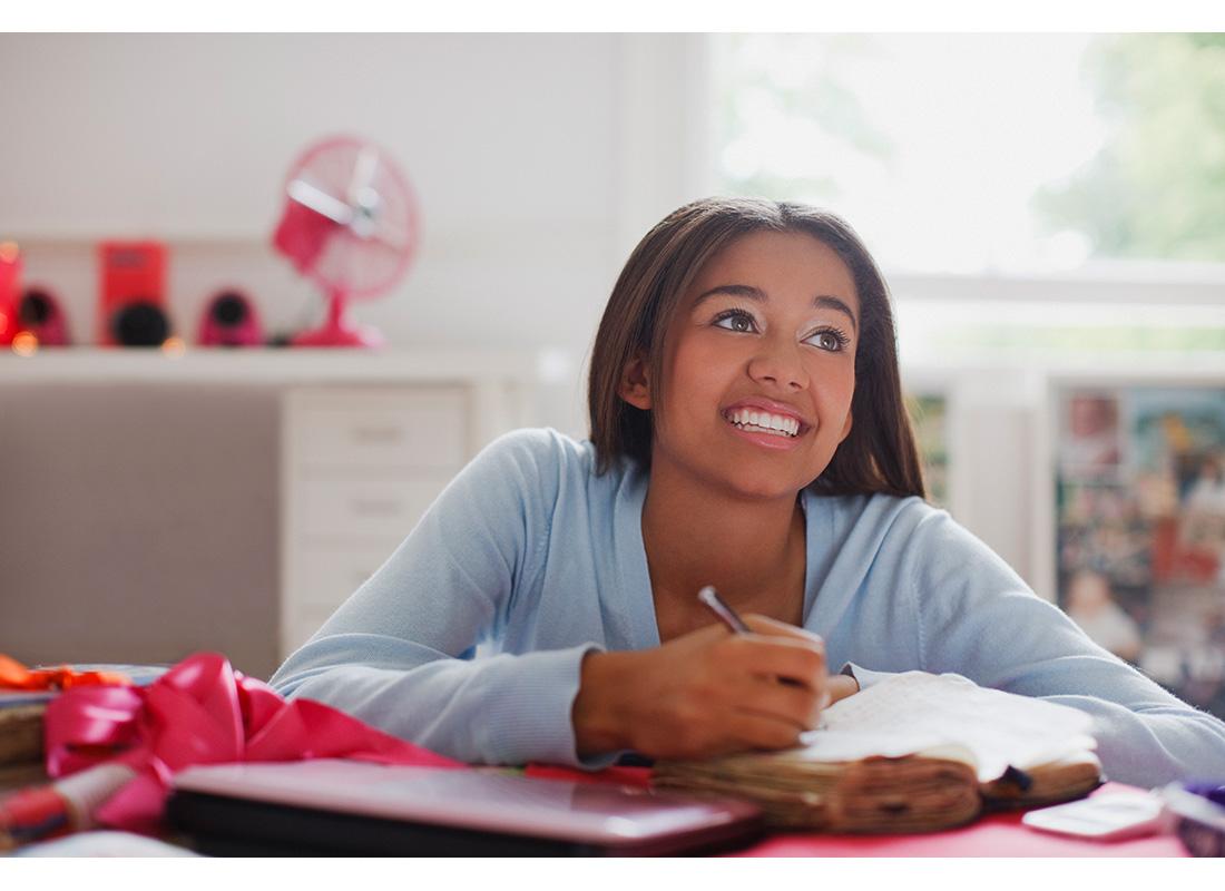 teen writing in journal