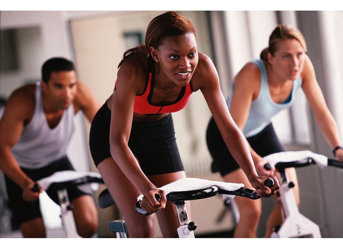 woman riding bike at gym