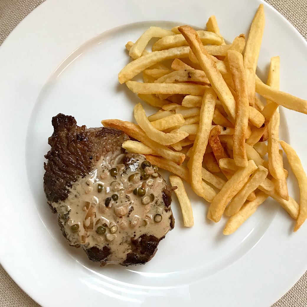 steak frites on plate