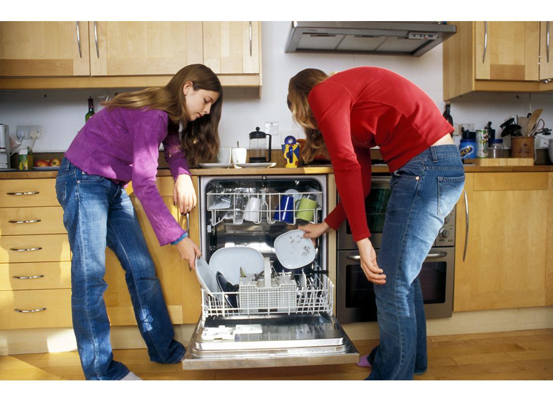 teens loading dishwasher