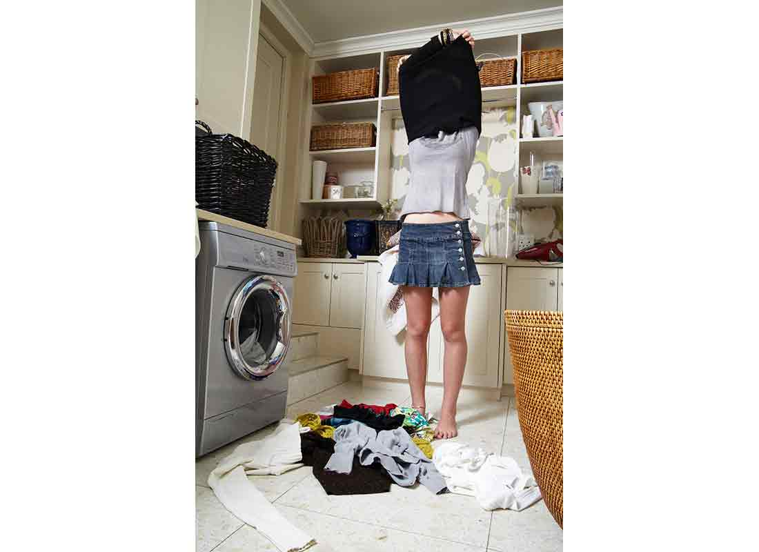 teen girl changing clothes with laundry on floor