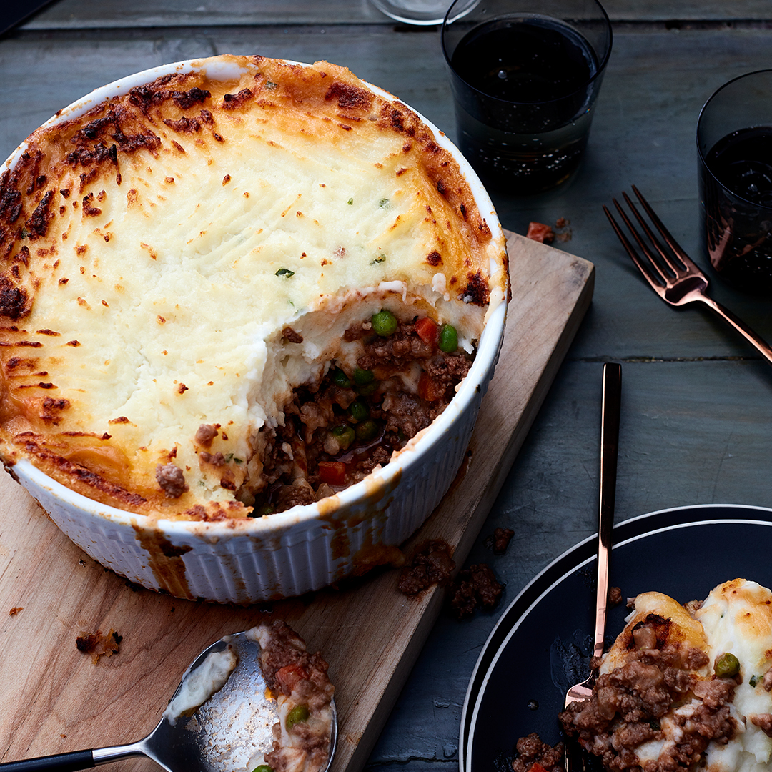 Instant Pot Shepherd's Pie in baking dish on wooden board