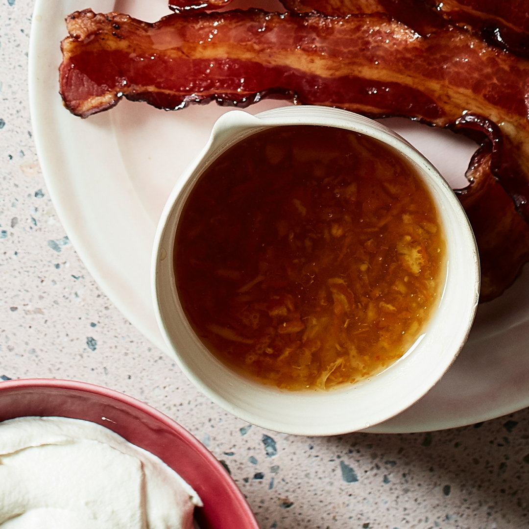 Rum-Marmalade Sauce in cup with bacon
