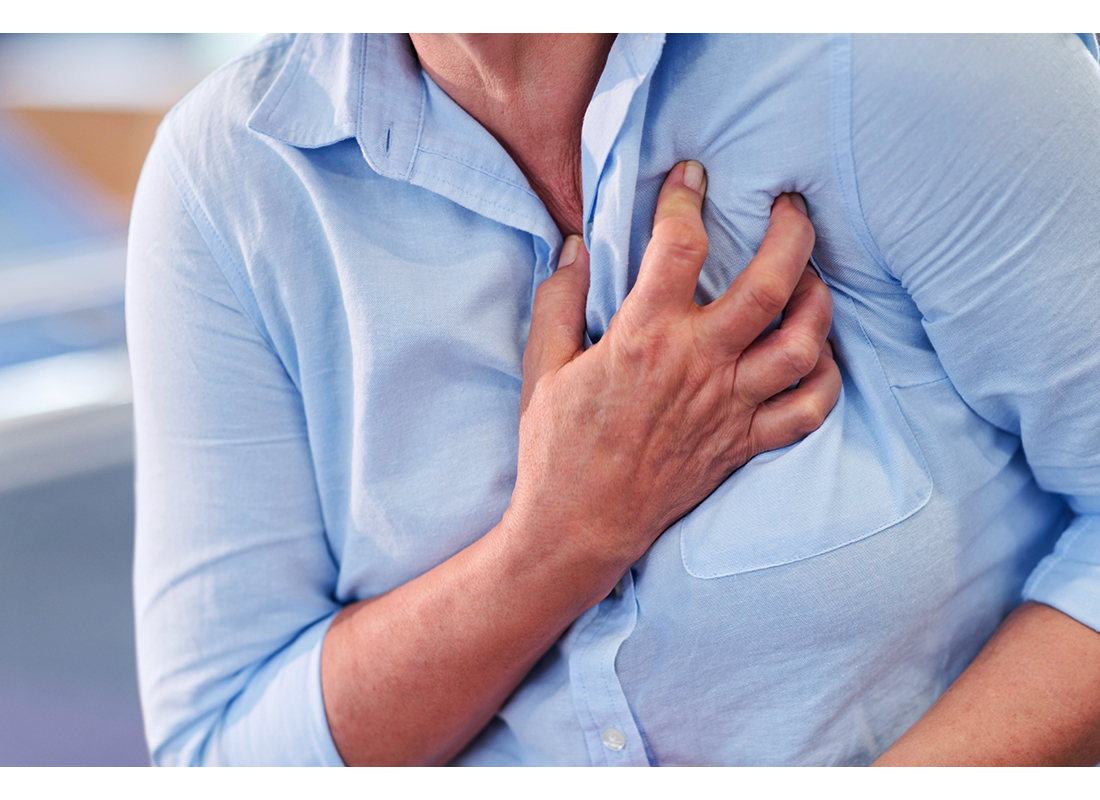 woman clutching chest