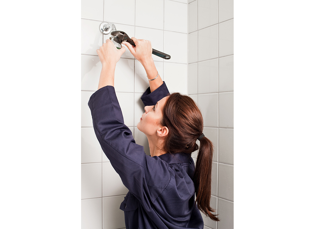 woman changing a showerhead