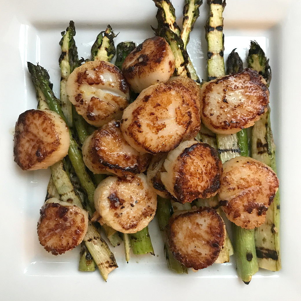 scallops and grilled asparagus on plate