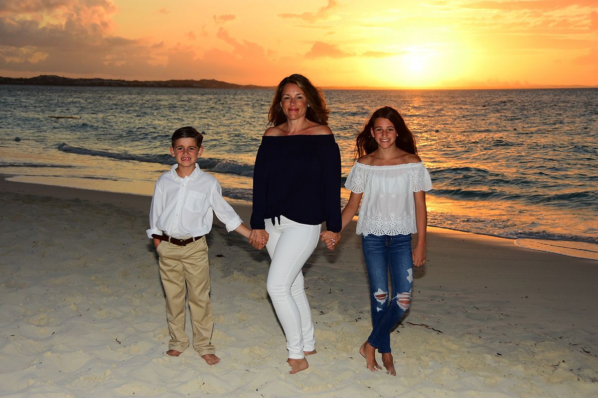 Amy Ruggiero poses on beach with her children, post-weight loss