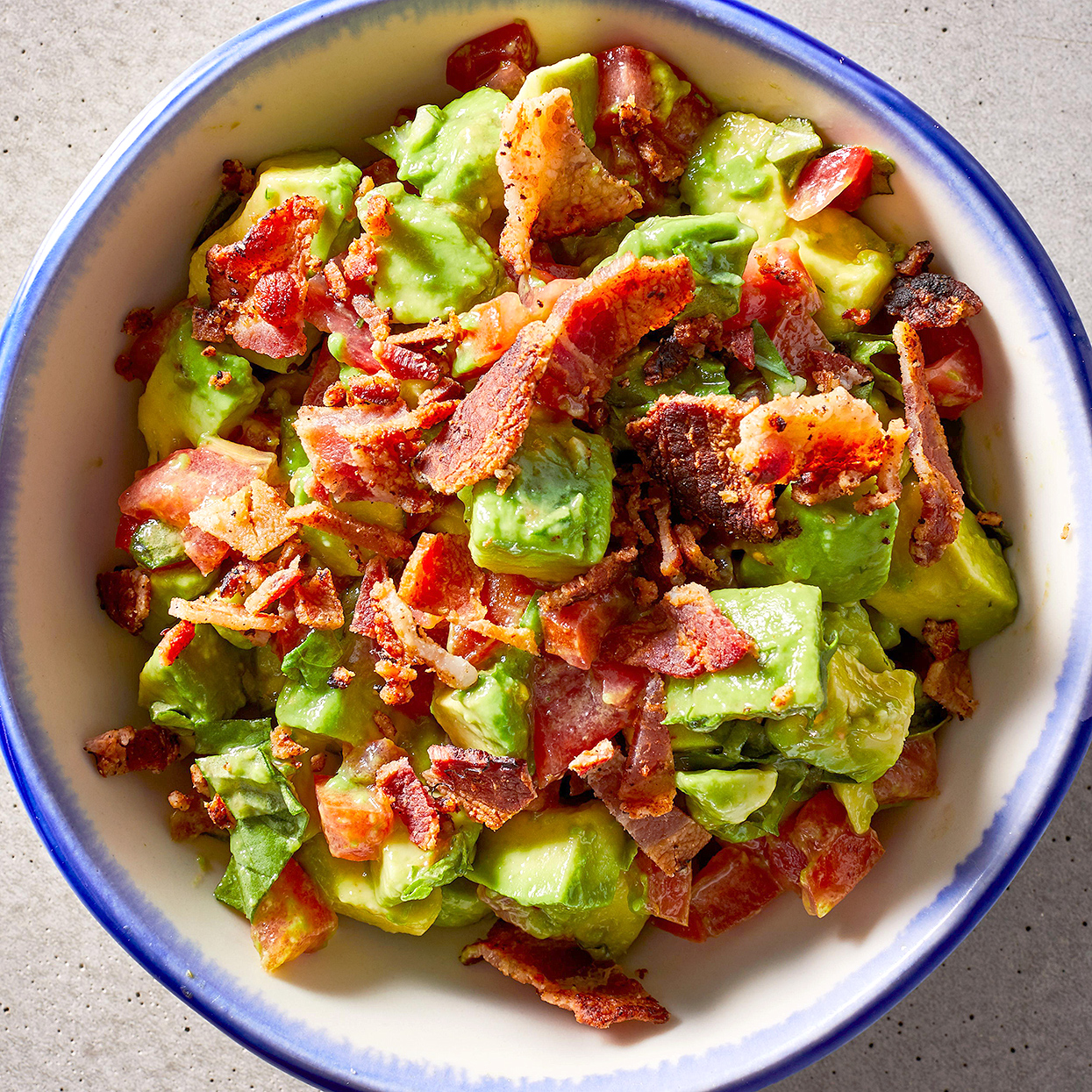 bacon-tomato guacamole in bowl