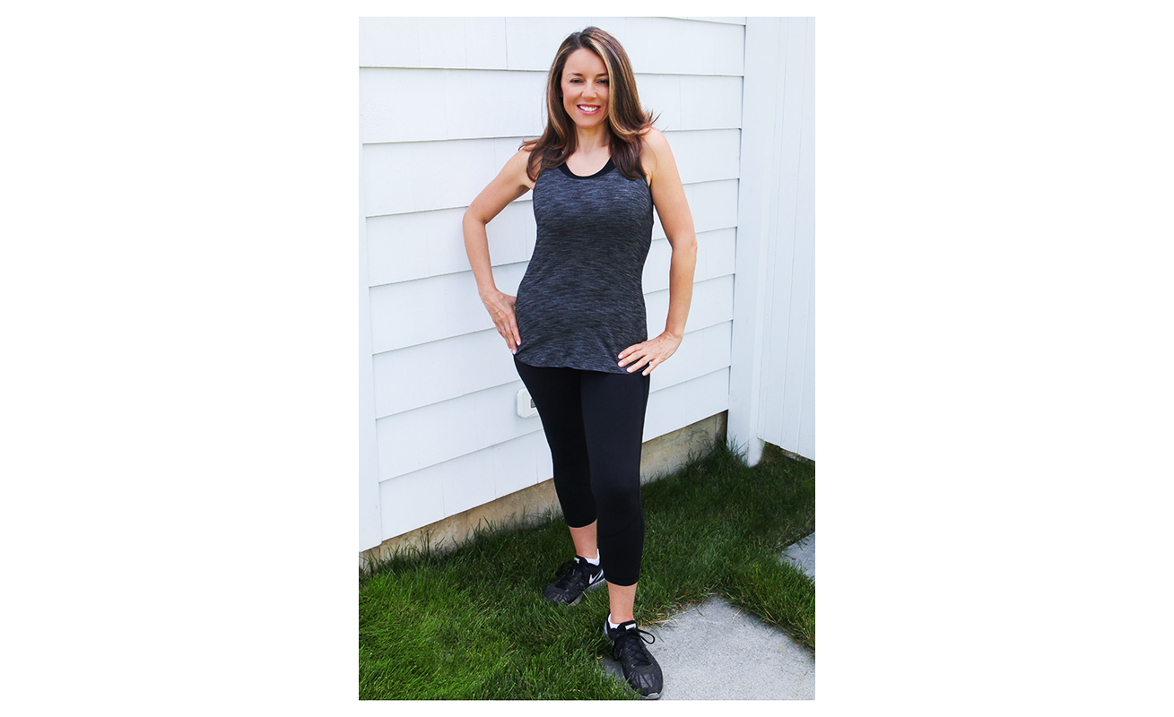 Amy Ruggiero, after her weight loss, poses in workout attire
