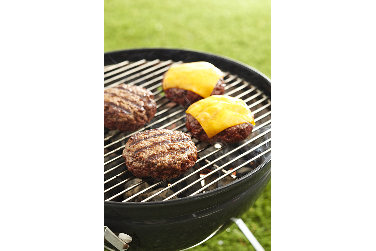 cheeseburgers on a grill