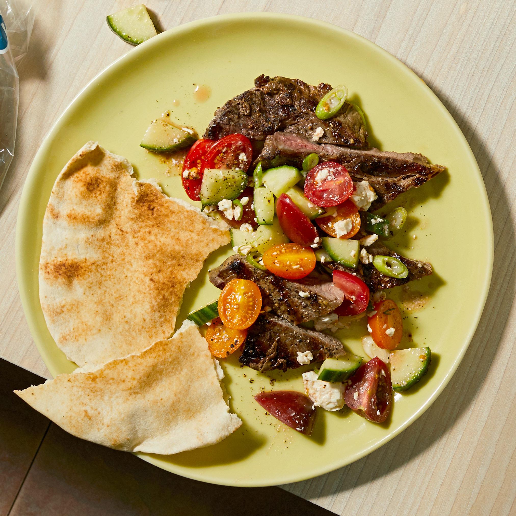 greek steak and salad on plate