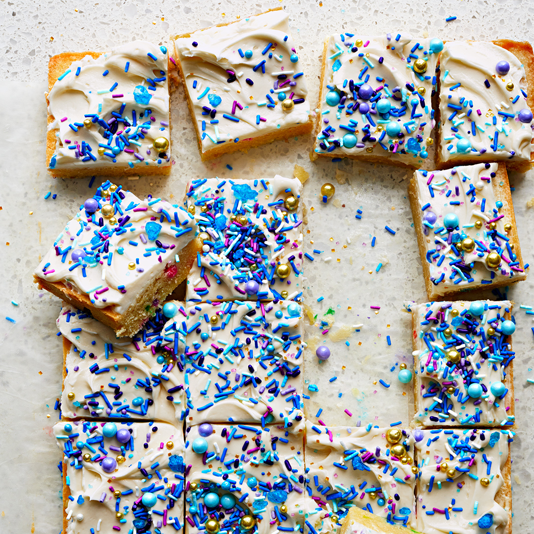 birthday cake cookie bars with blue and purple sprinkles