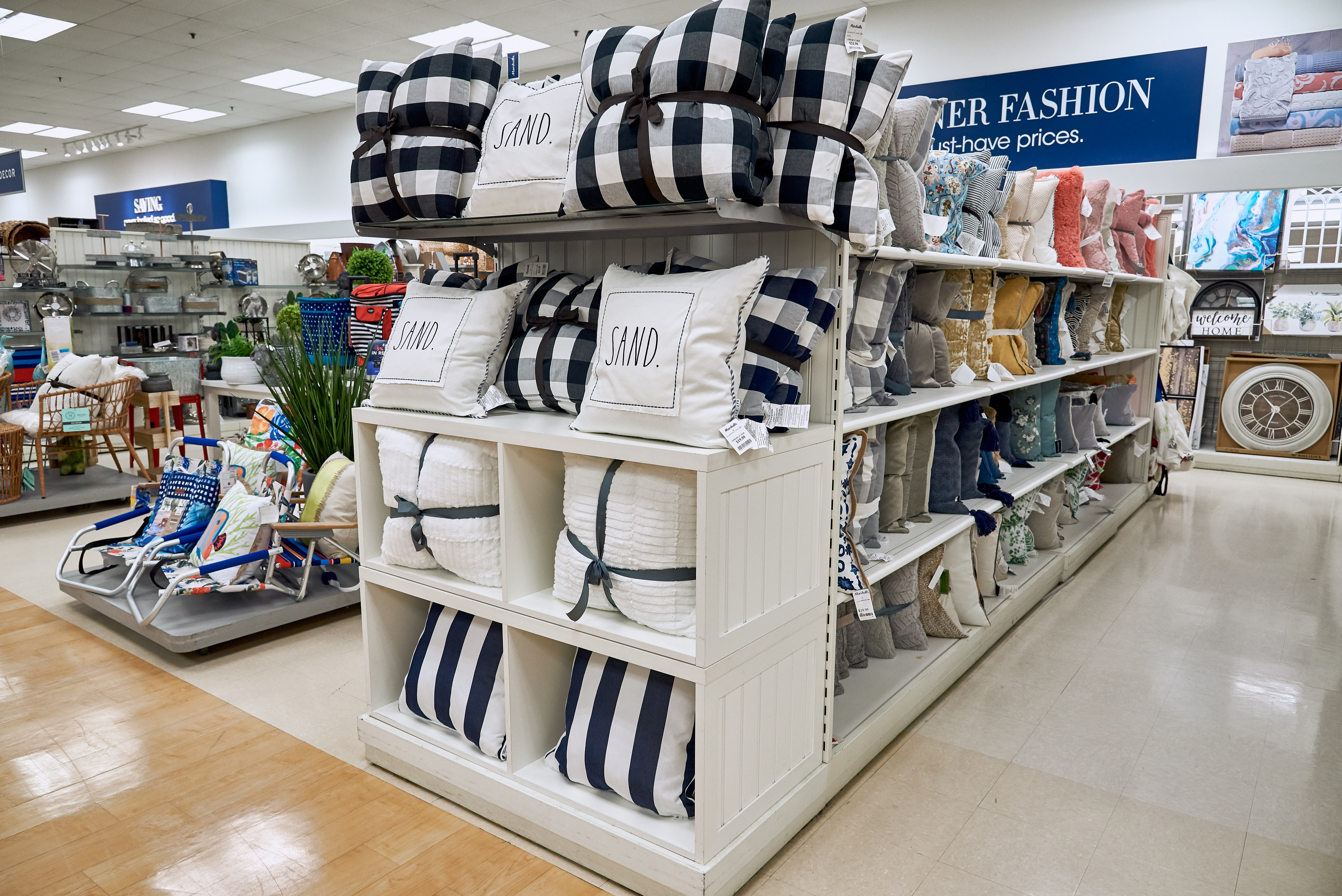 Pillows and throws in the home section of Marshall's store.