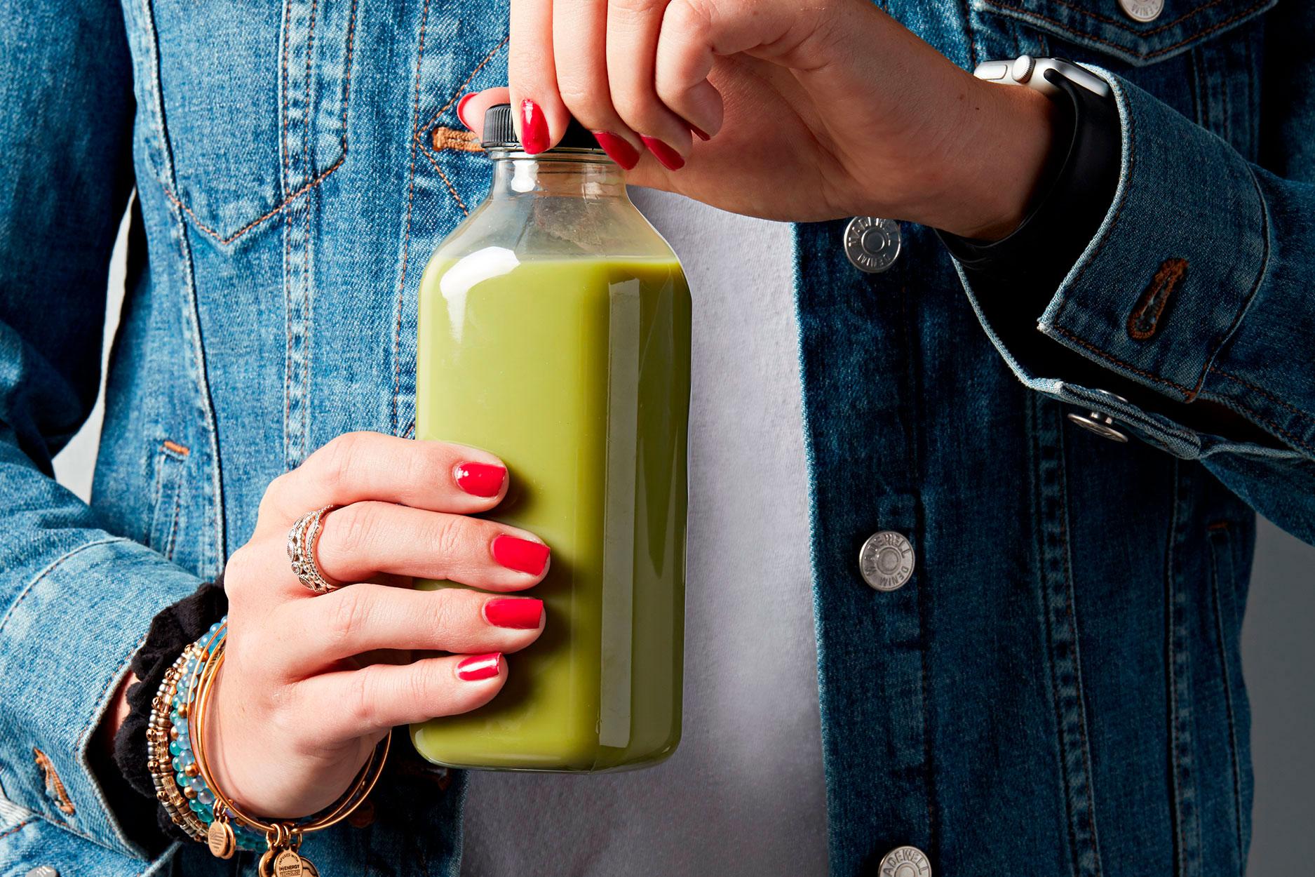 woman opening juice bottle