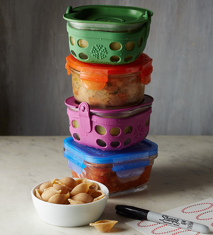 Stack of storage containers containing soups