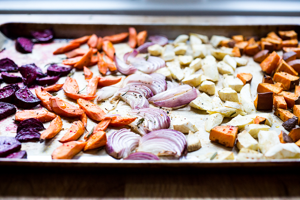 onions carrots beets on baking sheet
