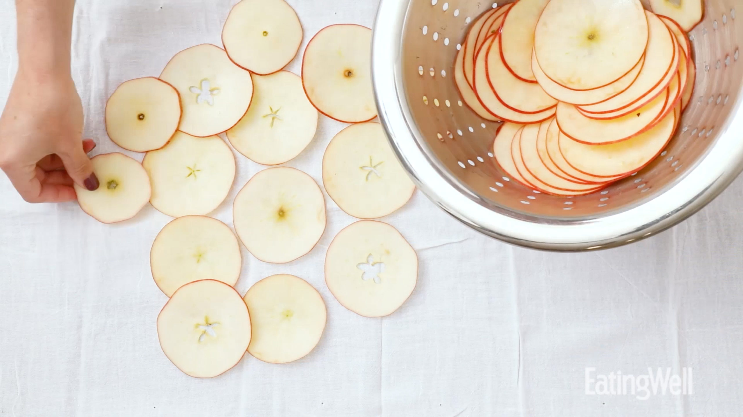 drying apple slices on a cloth