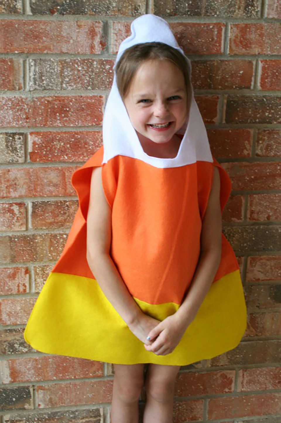 child wearing a candy corn costume