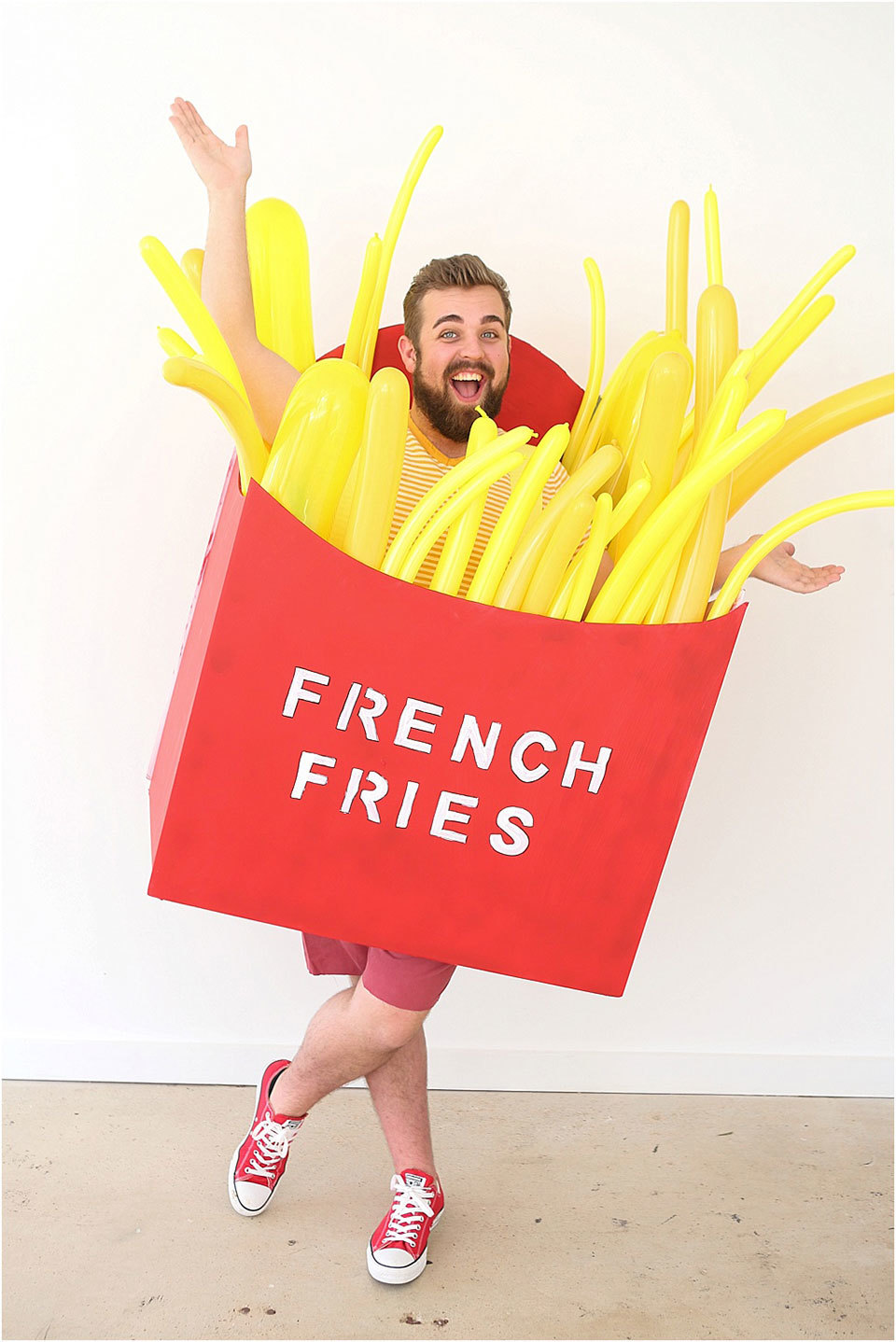man wearing french fries costume