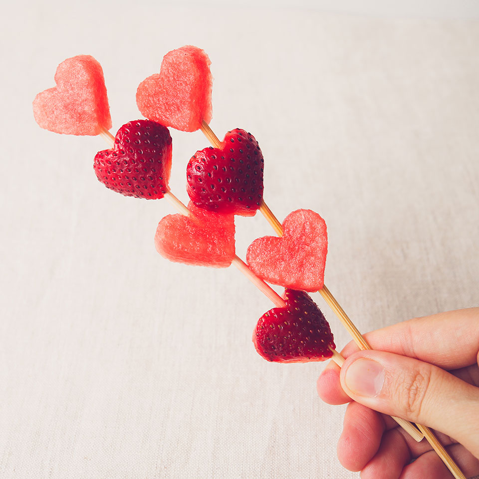 heart shaped watermelon and strawberries on a skewer