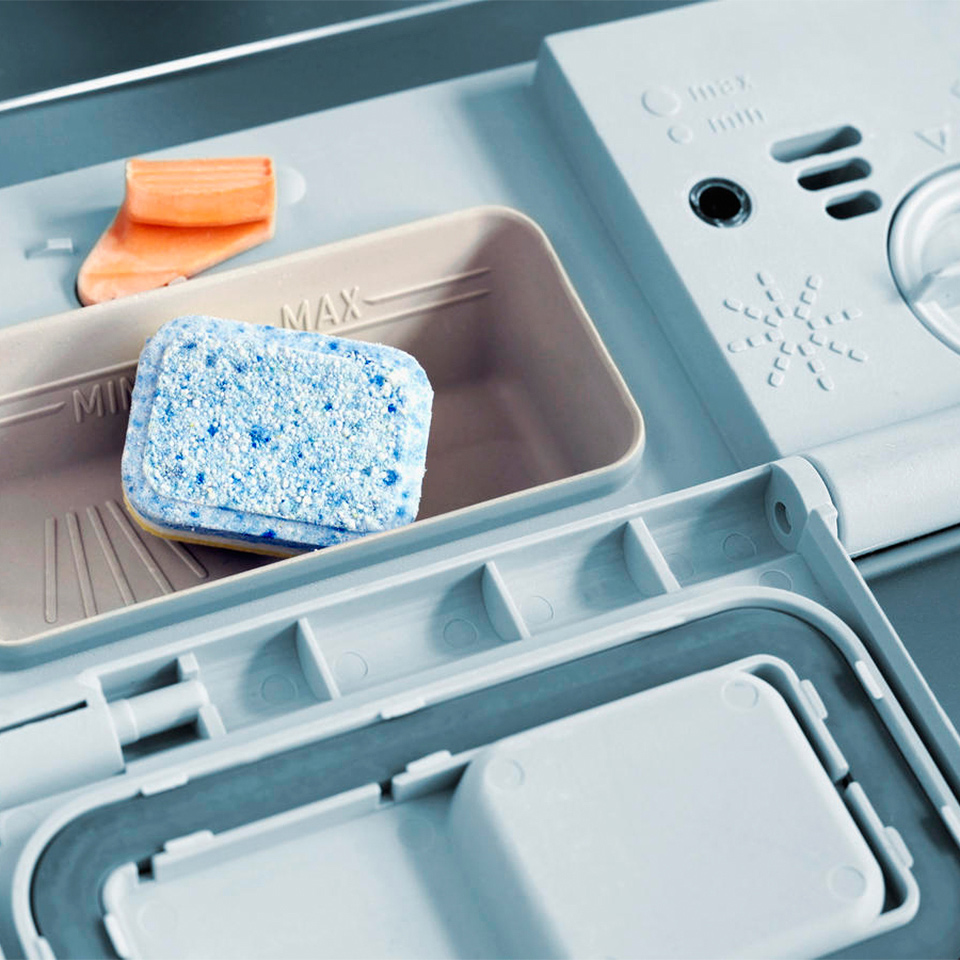 close up inner door of dishwasher with soap pack