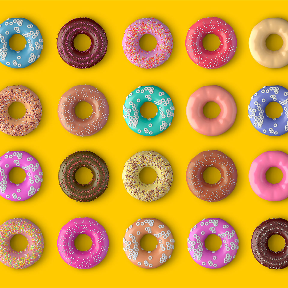 colorful grid of sprinkled donuts