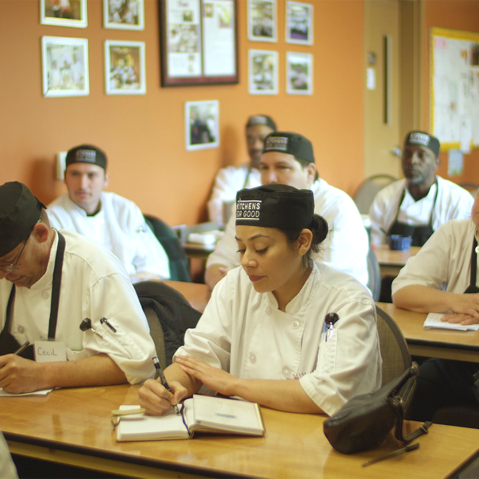 people sitting in class room of kitchens for good