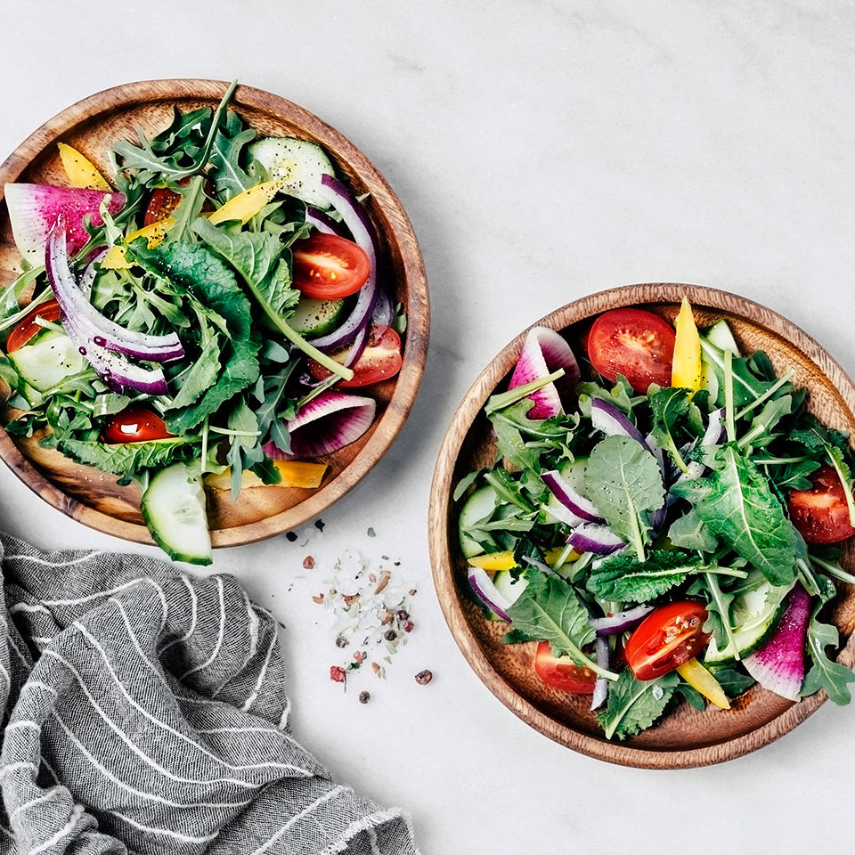 Two bowls of salad