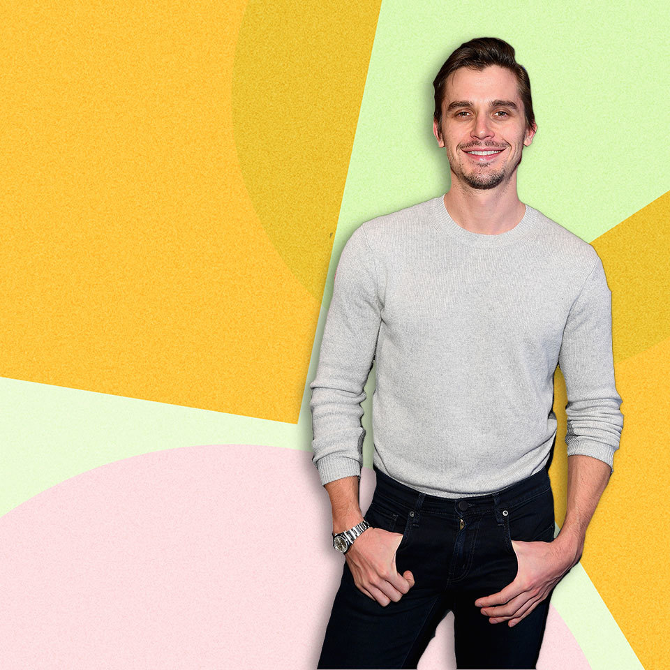 Antoni Porowski standing against a colorful background
