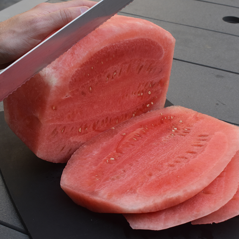 Cut the watermelon into planks.