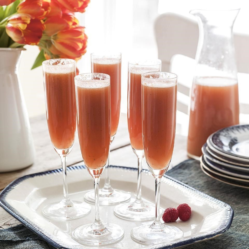 Sunrise Bellini drinks in flutes