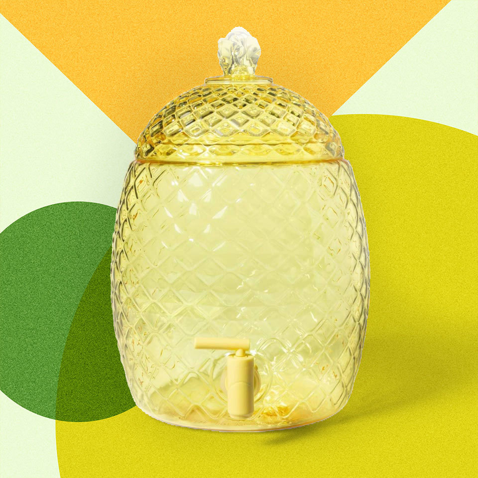 Yellow pineapple design on a drink dispenser with spigot