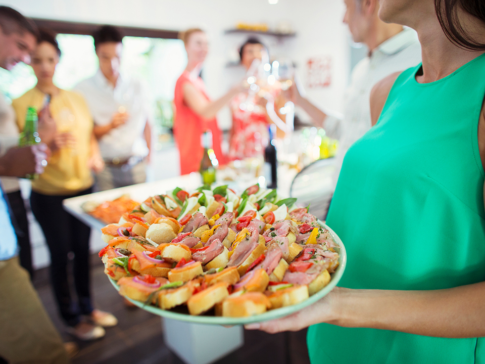 woman holding a tray of hors d'oeuvres