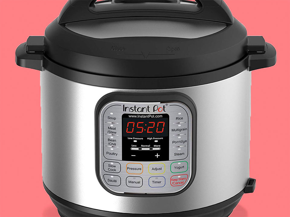 Instant Pot against a coral colored background