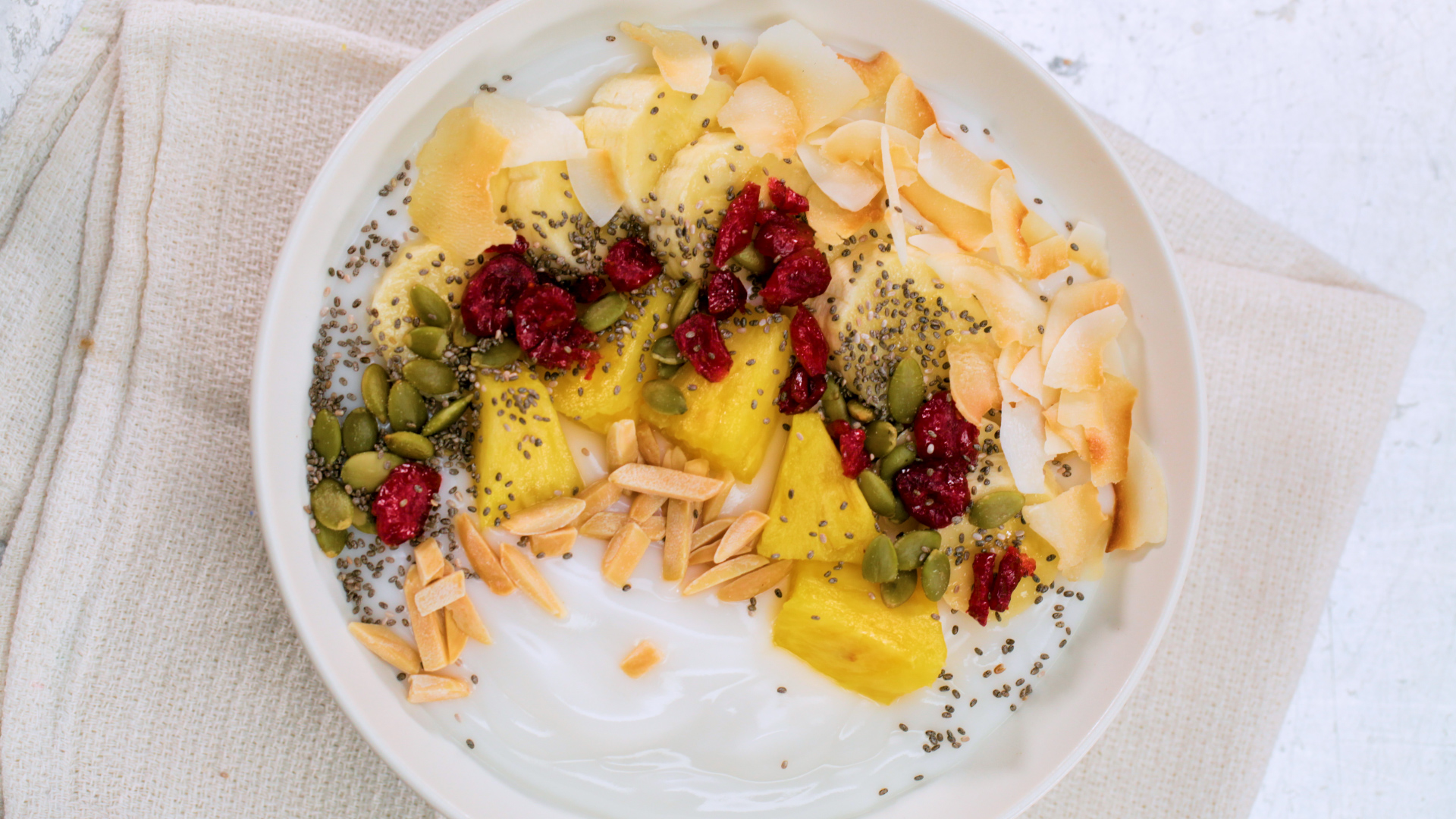 yogurt bowl with fruit and seeds from above