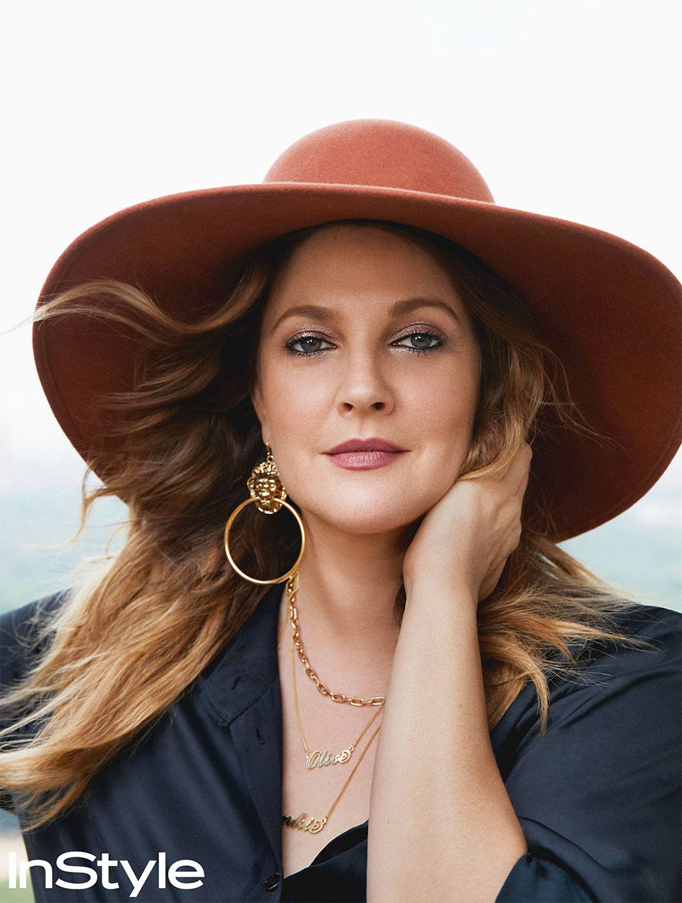 Drew Barrymore wearing a large-brimmed hat