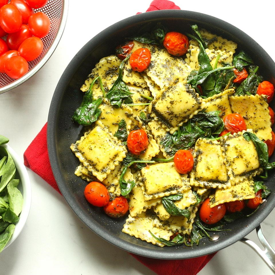pan of Pesto Ravioli with Spinach and Tomatoes