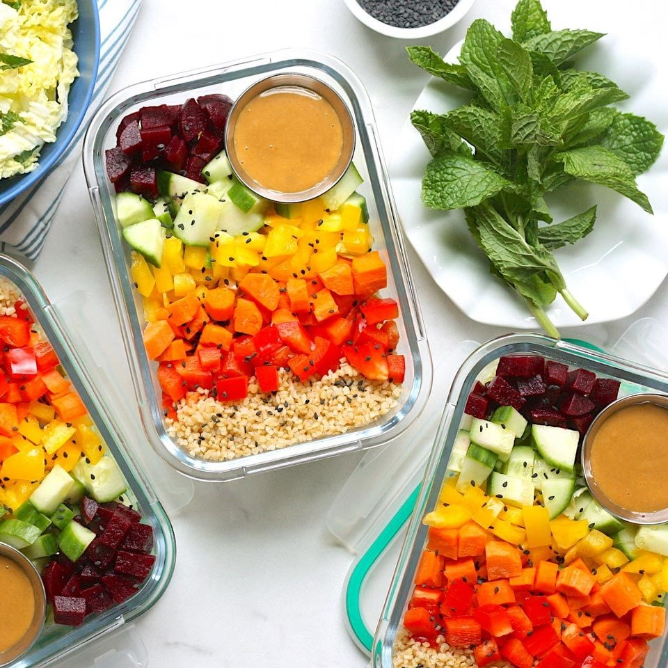 containers of chopped rainbow salad with peanut sauce