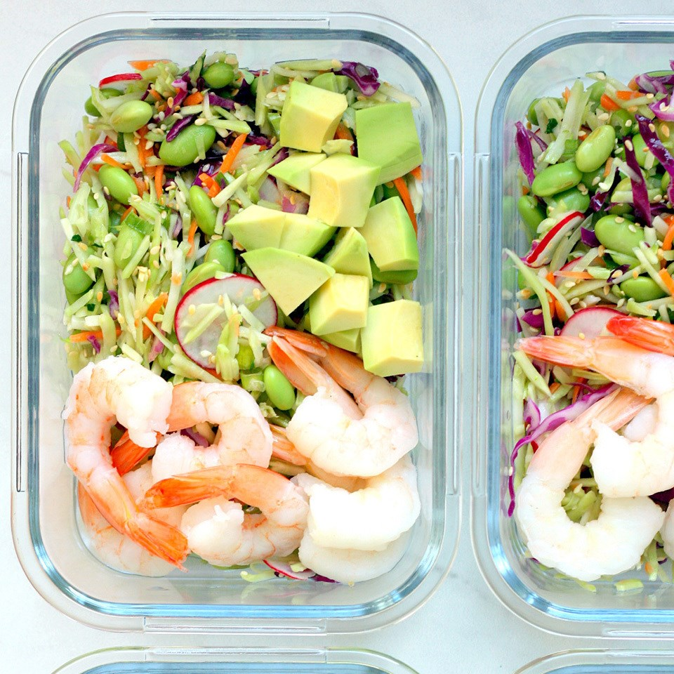 containers with spicy slaw bowls with shrimp & edamame