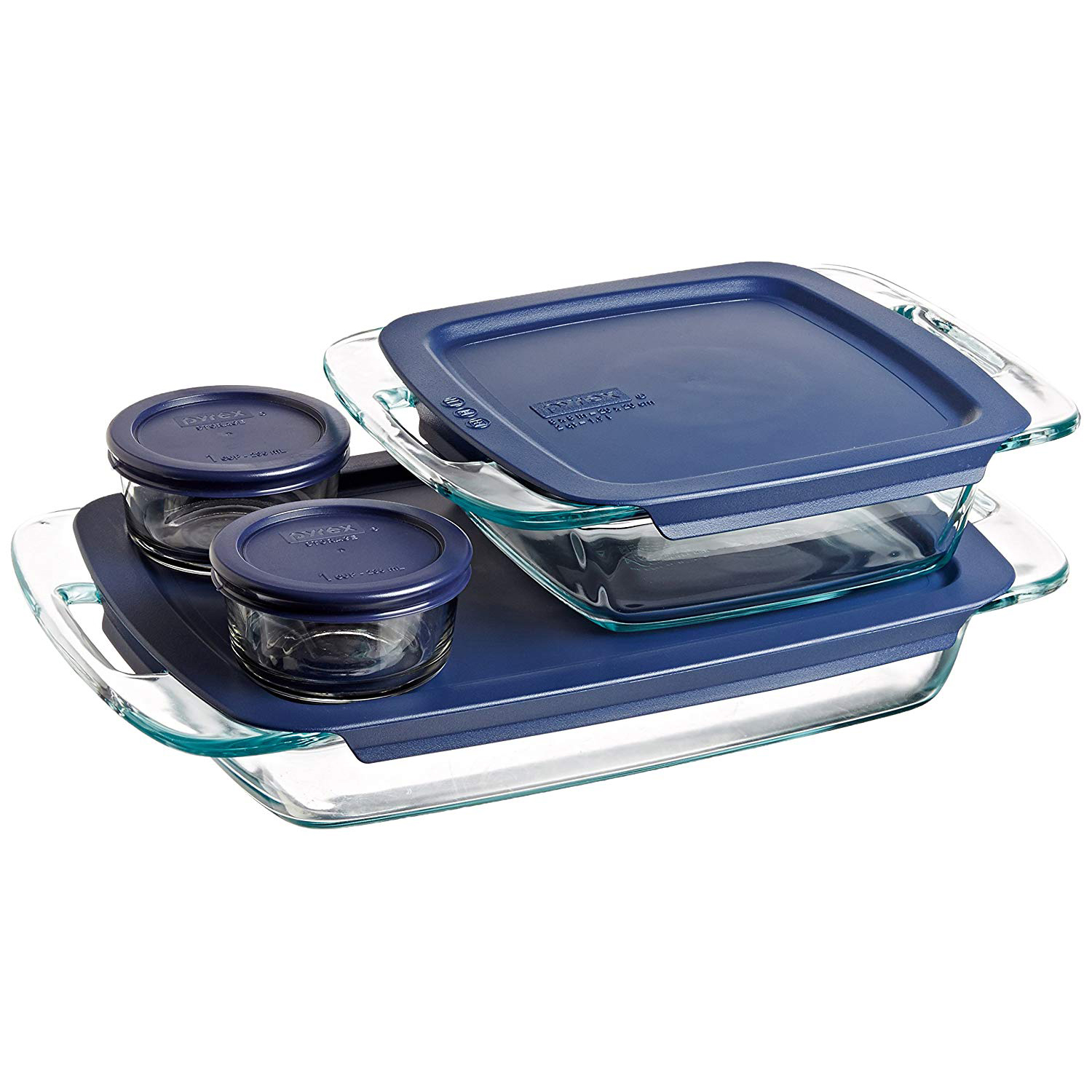 Pyrex casserole dishes with lids and two small round containers with lids