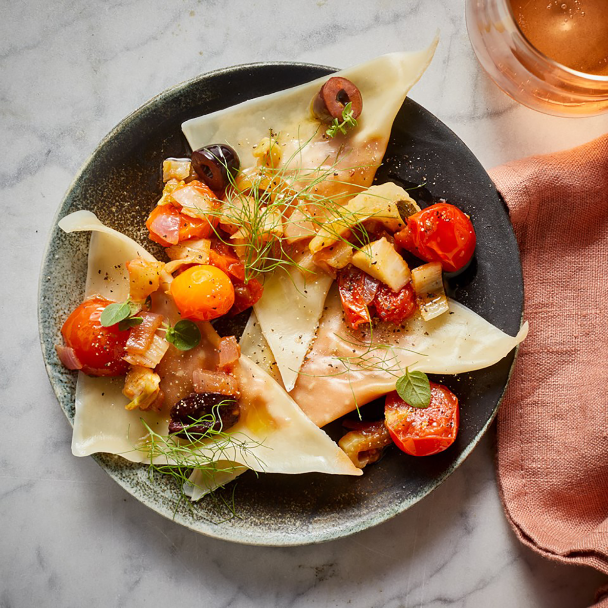 This easy ravioli recipe features exotic North African Mediterranean flavors. The sweet pumpkin takes on the fennel and oregano flavors well; the salty olives and cheese combined with acidic tomatoes and lemon balances everything out. Look for wonton wrappers in the refrigerated section of the deli.