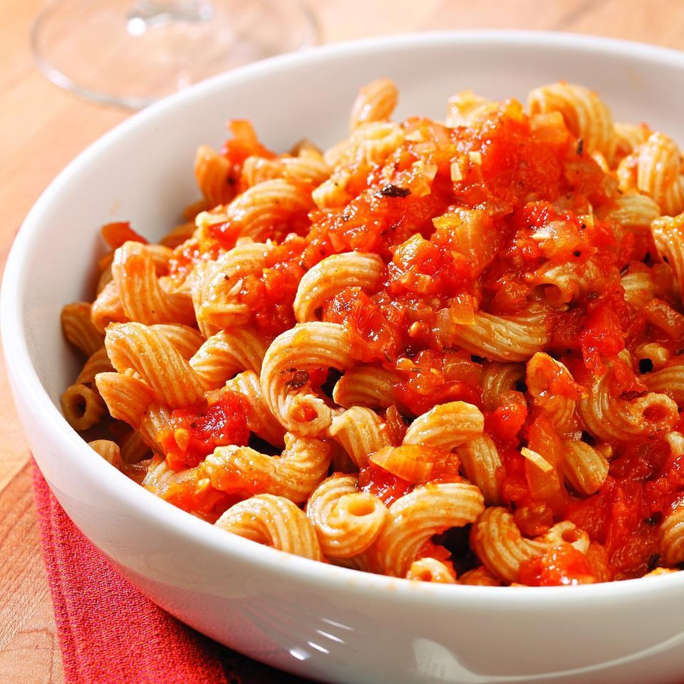 bowl of pasta with a red sauce