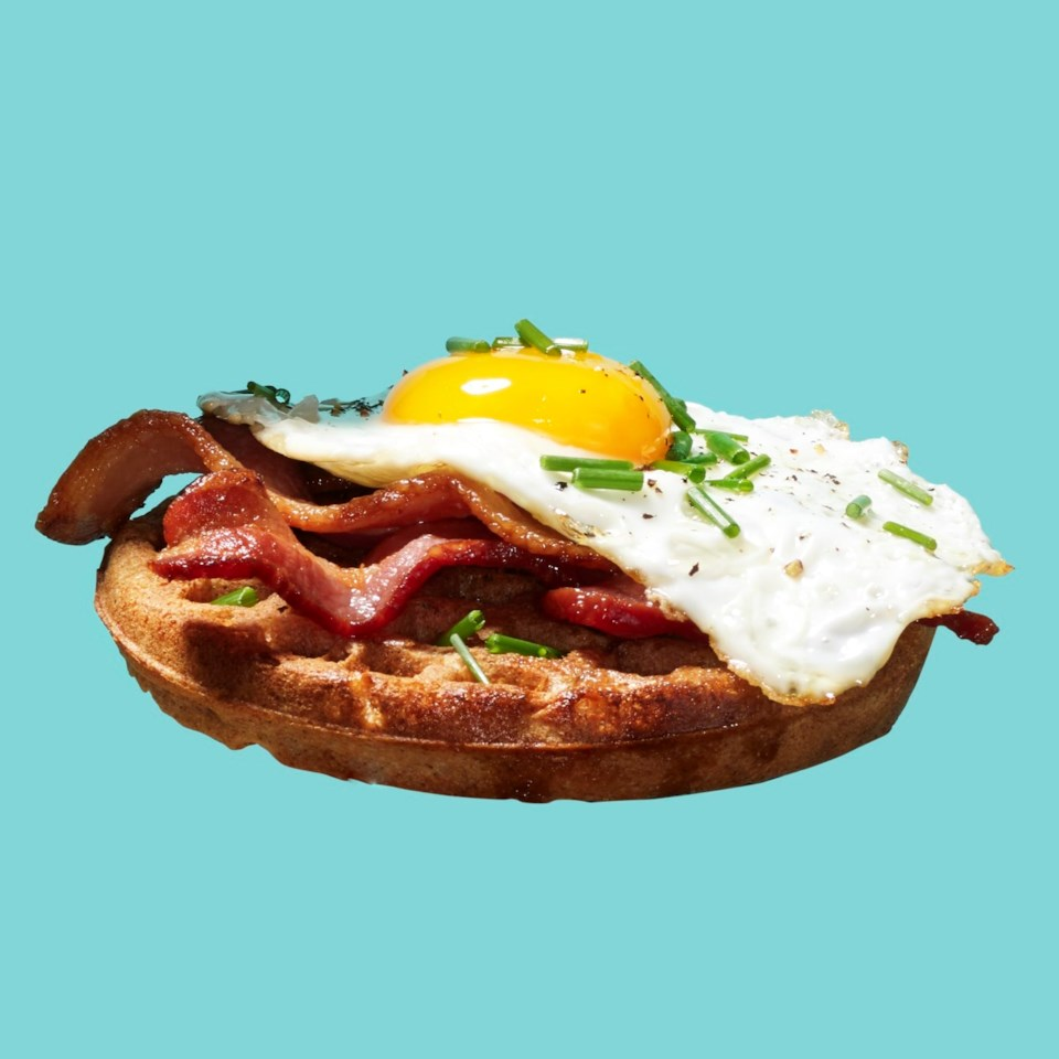 Frozen waffle with bacon, fried egg and chives
