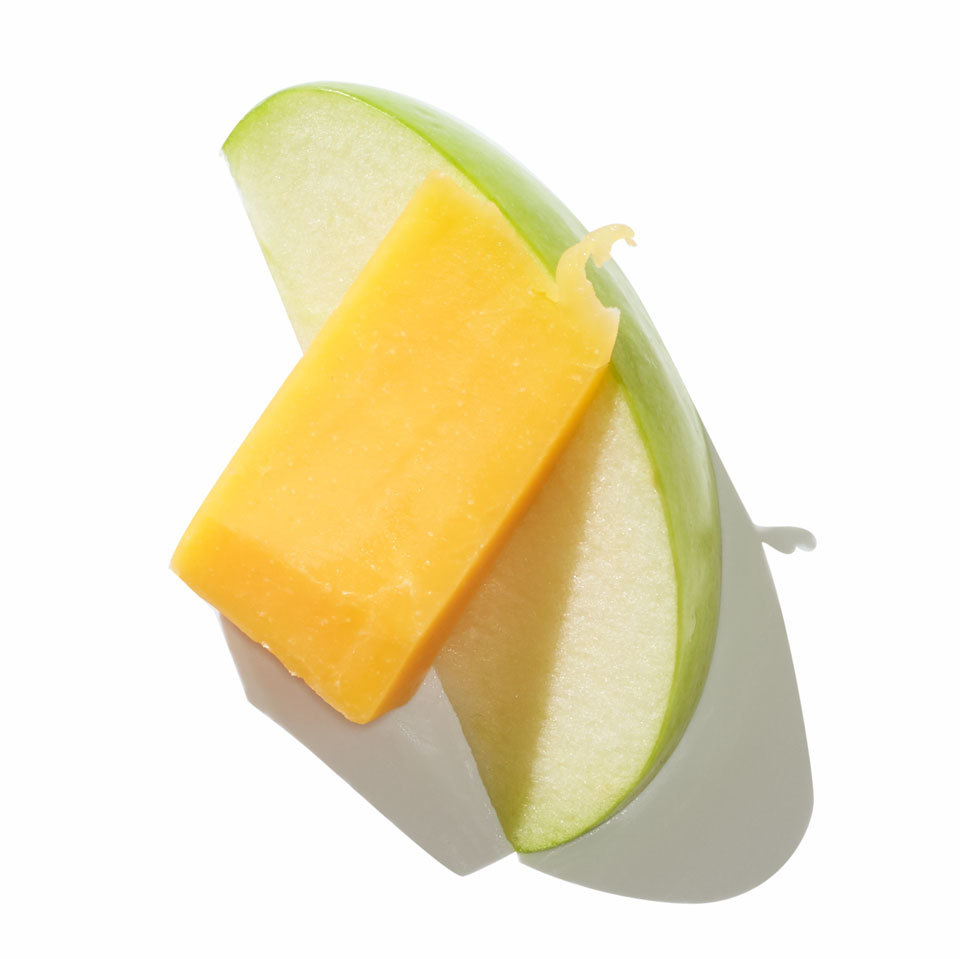 Apple slice with cheddar cheese
