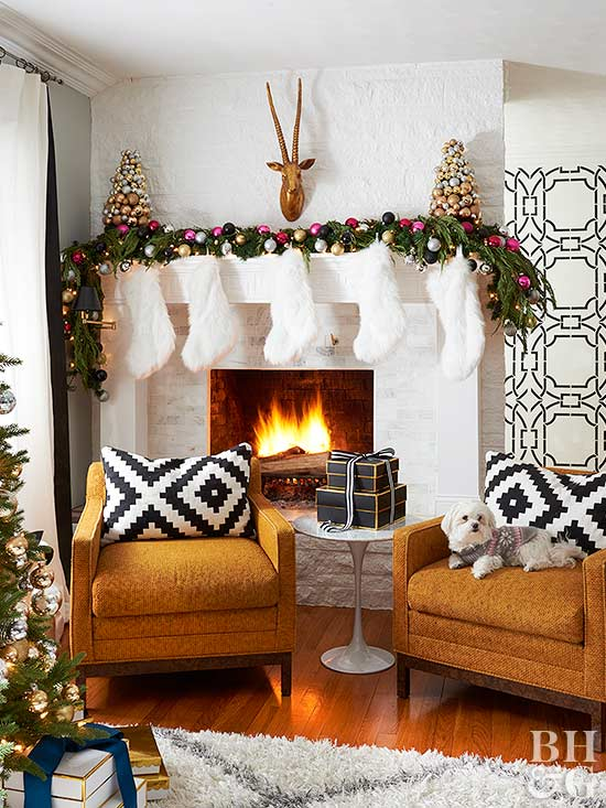 white fur stockings above white fireplace