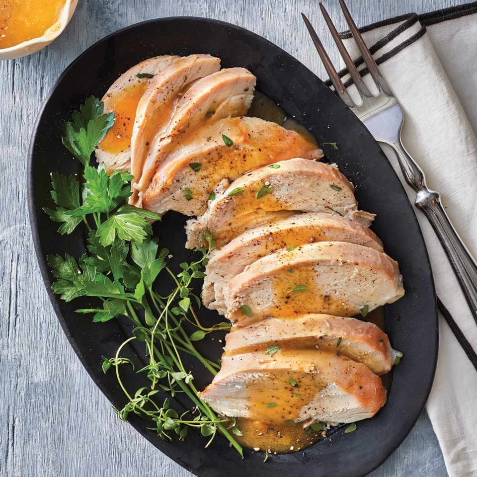 Slow-Cooker Maple Mustard Turkey Breast - sliced and plated with herb garnish